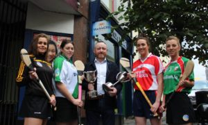 Katie Power(Piltown), Aine Fahey (Tullaroan) Tom Britton (Marble City Travel, Sponsors), Denise Gaule (Windgap) and Stacey Quirke (St Martins) at the launch of the new sponshorship deal with Marble City Travel.