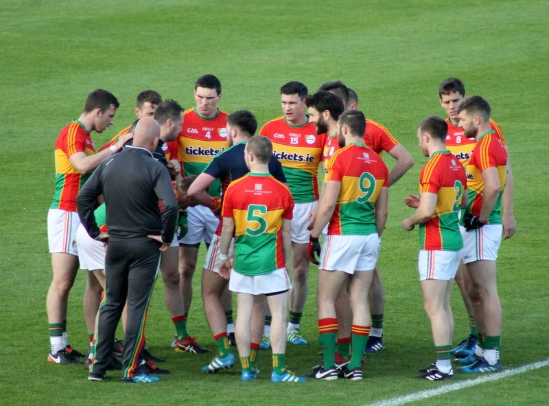Carlow Footballers in a huddle - Photo: Anne Lawlor