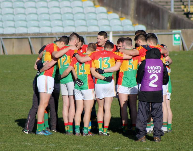 Carlow Footballers huddle - Photo: Anne Lawlor
