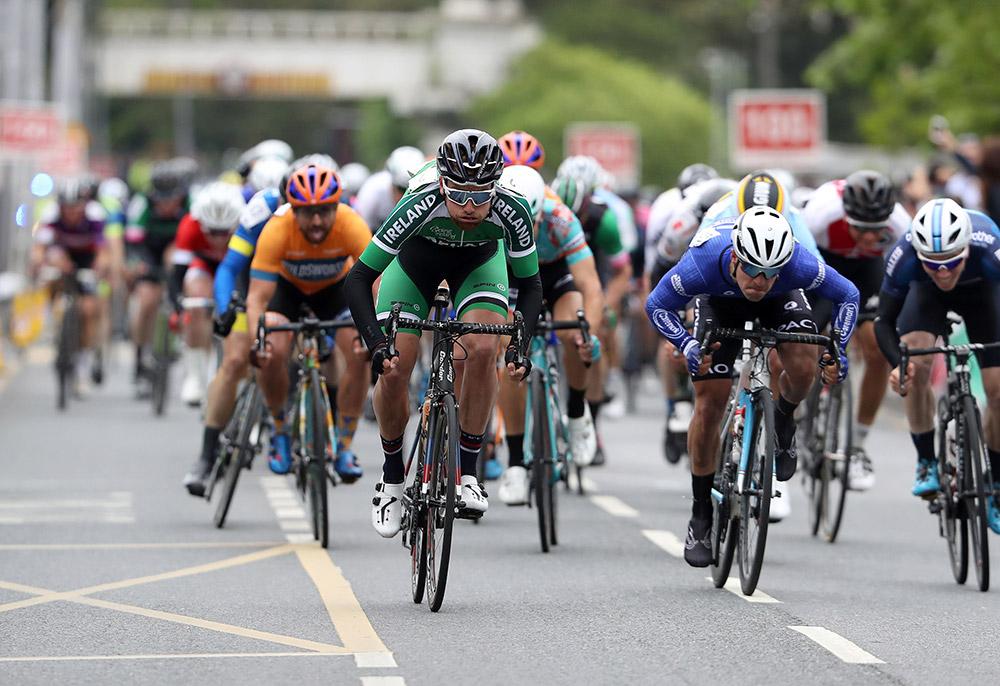 Ireland National Team's Robert-Jon McCarthy sprints for 11th place ahead of Viner-Caremark-Pactimo's Matteo Cigala Mandatory Credit ©INPHO/Bryan Keane