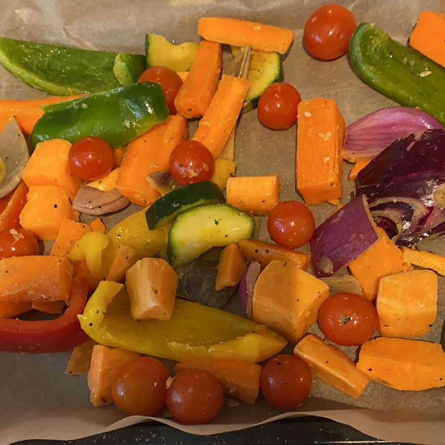 A tray of fresh vegetables bound for the oven.